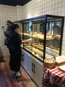 Bakery cases just being filled as we left